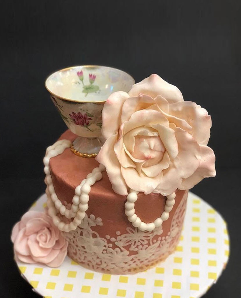 tea party cake, chocolate cake with teacup and flower